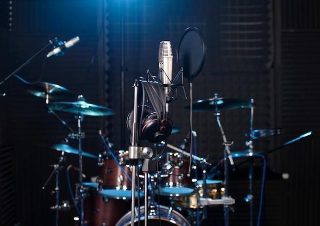 Recording studio with drum set, microphones and recording equipment. Premium Photo