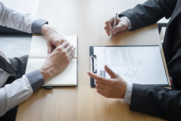 Recruiter holding reading a resume during about colloquy his profile of candidate Premium Photo