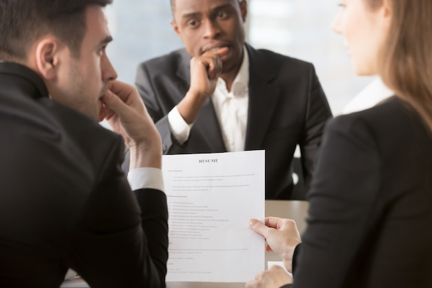 Recruiters doubting in truthfulness of resume Free Photo