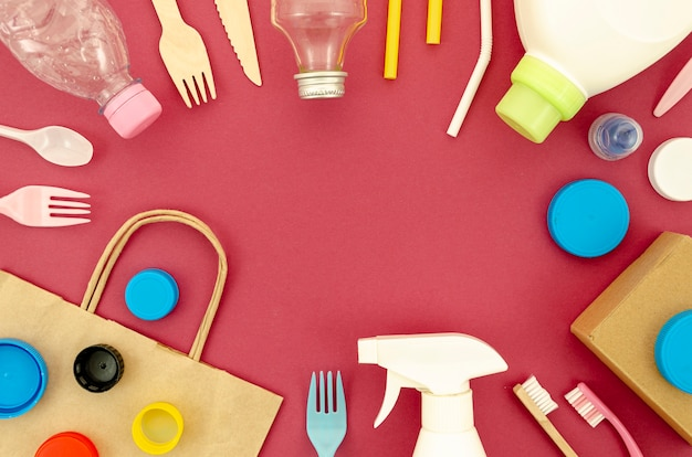Recyclable plastic parts on red background Free Photo