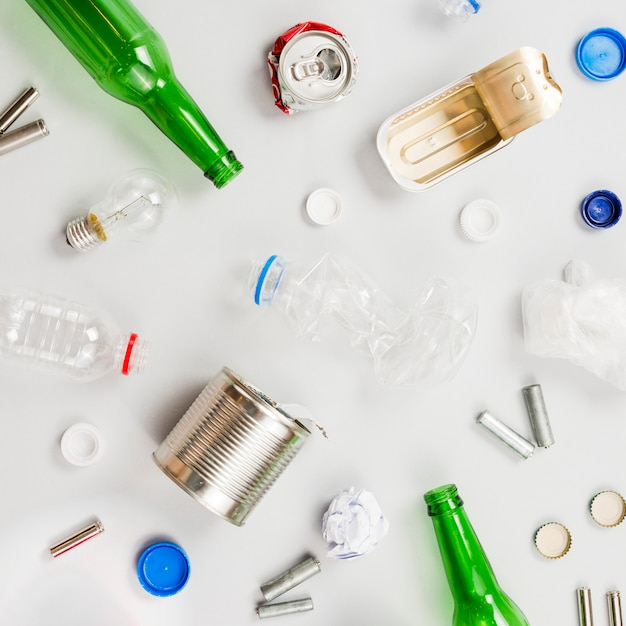 Recyclable trash scattering on grey table Free Photo