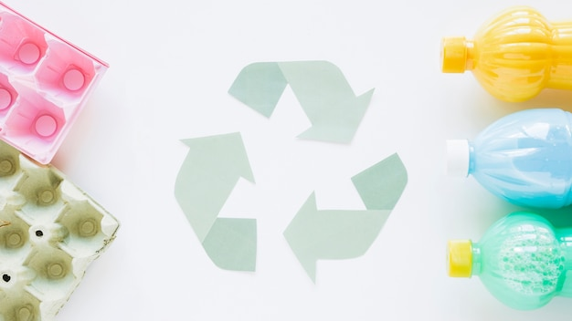 Recycle logo with bottles and carton Free Photo