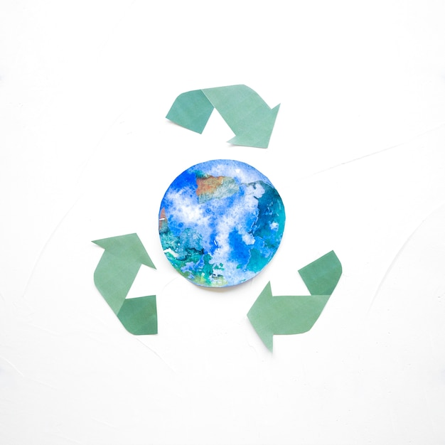 Recycle logo with globe drawing Free Photo