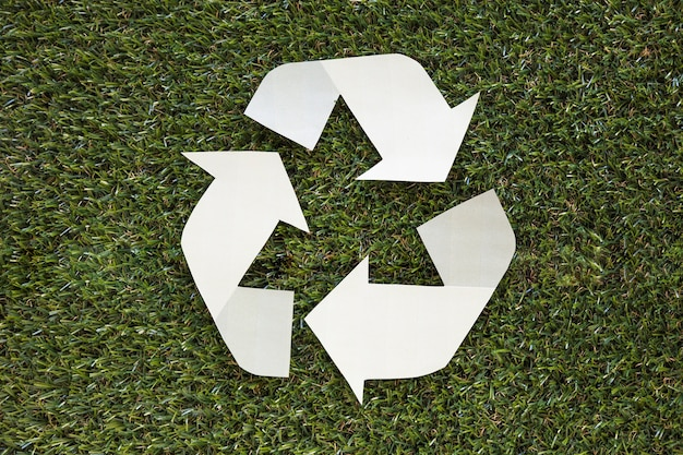 Recycle symbol on grass Free Photo