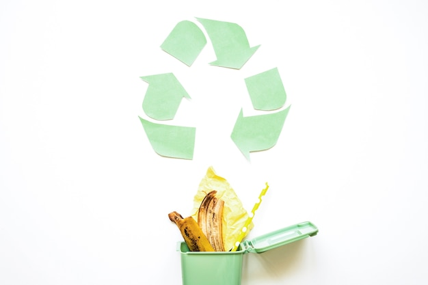 Recycle symbol with garbage bin Free Photo