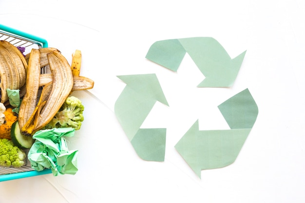 Recycle symbol with organic trash Premium Photo