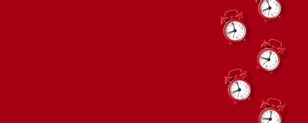 Red alarm clock on red Premium Photo