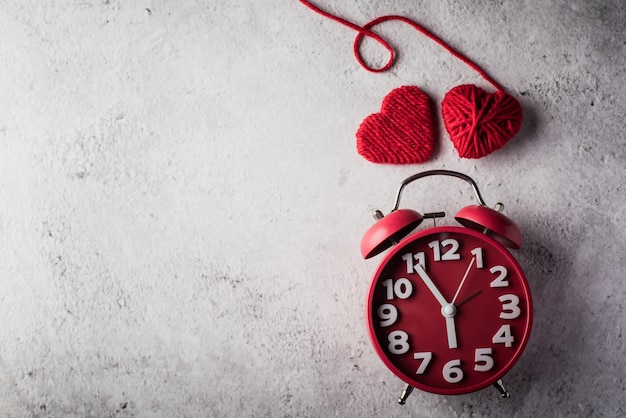 Red alarm clock with red heart, valentines day concept. Free Photo