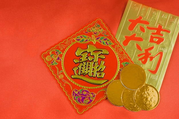 Red and gold card with some coins Free Photo
