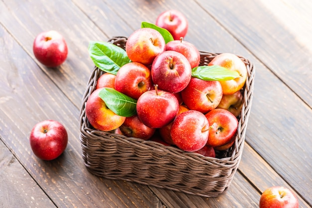 Red apple in basket Free Photo