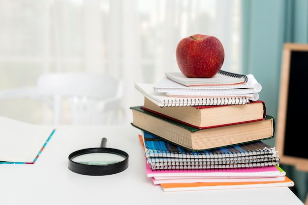 Red apple on school supplies Free Photo
