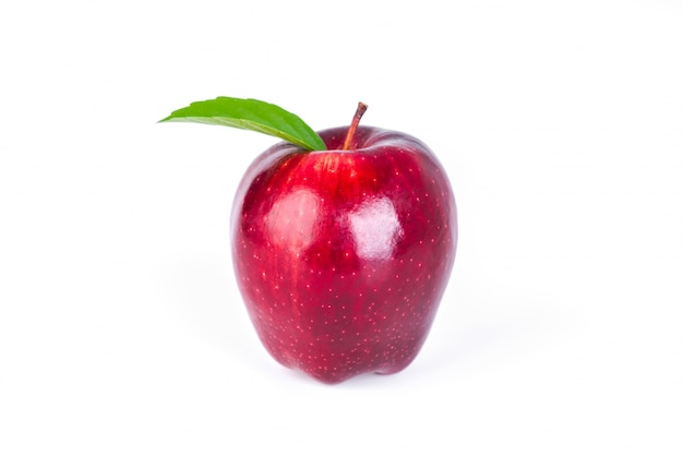 Red apple with green leaf on white background . Free Photo