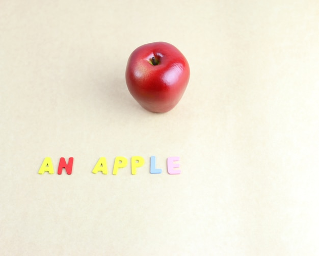Red apple with letters Premium Photo