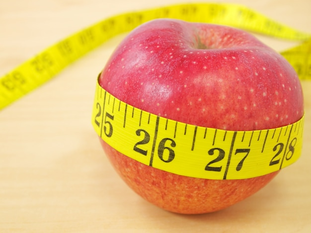 Red apple and yellow measure, healthcare and diet concept Premium Photo