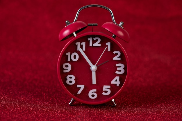 Red background image and beautiful red alarm clock concept, time, date Premium Photo