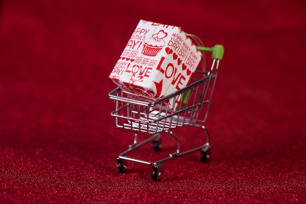 Red background and shopping trolley shopping concept and trading Premium Photo
