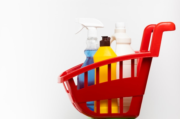 Red basin with different cleaning products Free Photo