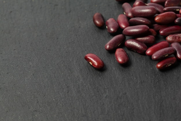 Red beans on the black table Premium Photo