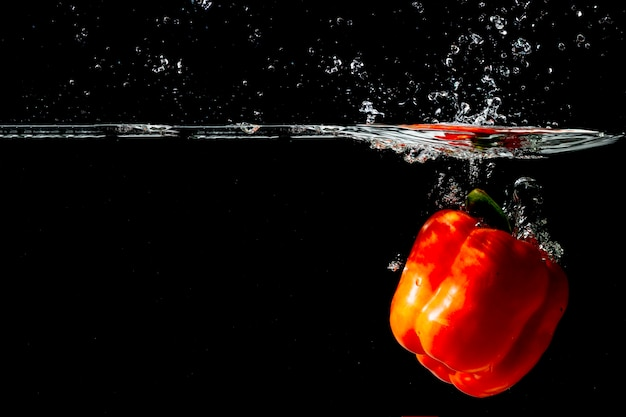 Red bell pepper floating under the clear water Free Photo