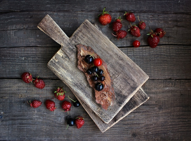 Red berry strawberry, wooden rustic background. organic natural products. Premium Photo