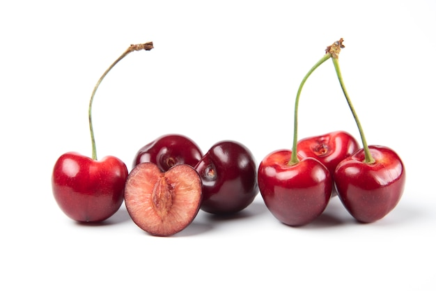 Red and black cherries on white background Free Photo