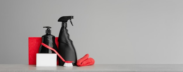 Red and black set of tools and tools for cleaning the kitchen. neutral background.copy space. Premium Photo