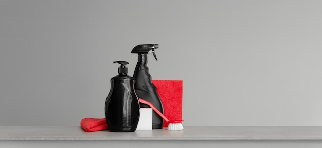 Red and black set of tools and tools for cleaning the kitchen Premium Photo