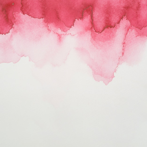 Red blots of paints on white paper Free Photo