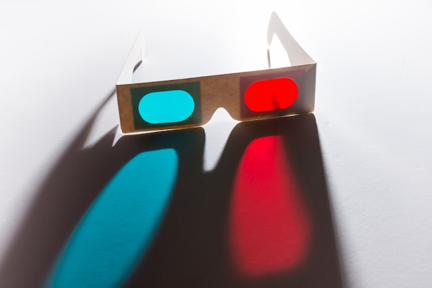 Red and blue 3d glasses on reflective white background Free Photo