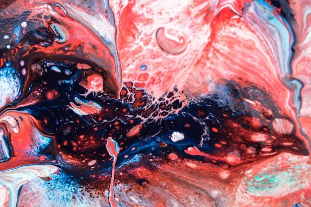 赤青大理石の宇宙液体インクの質感 Premium写真