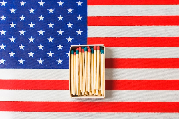 Red and blue matchstick on usa flag Free Photo