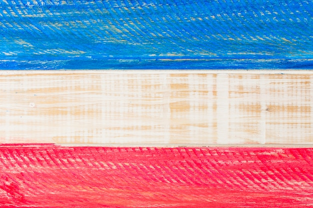 Red and blue usa painted flag on wooden plank for independence day Free Photo