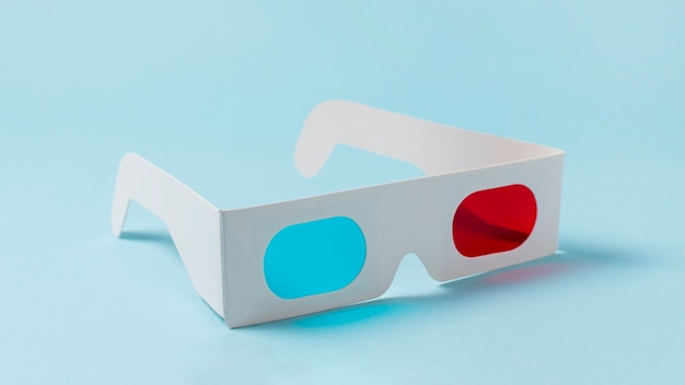 Red and blue white paper 3d glasses on blue background Free Photo