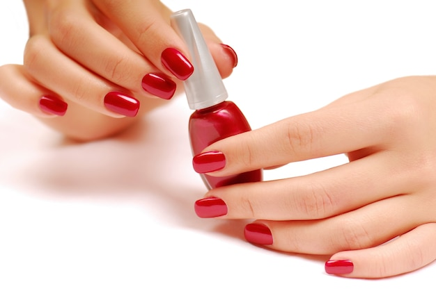 Red bottle of nail polish Free Photo