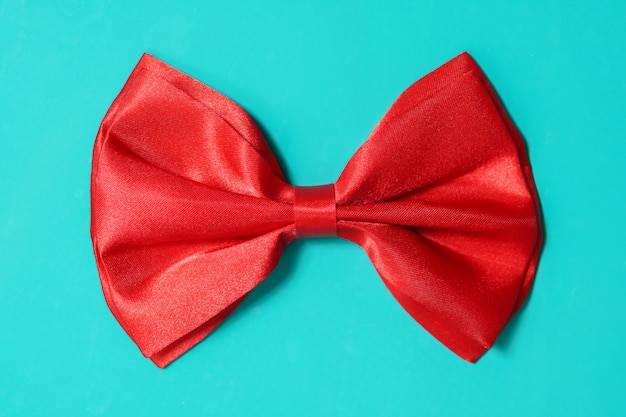 Red bow ite on green background Premium Photo