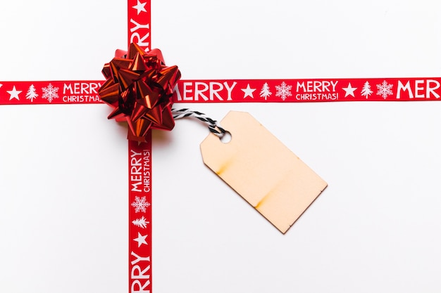 Red bow with greeting card for christmas Free Photo