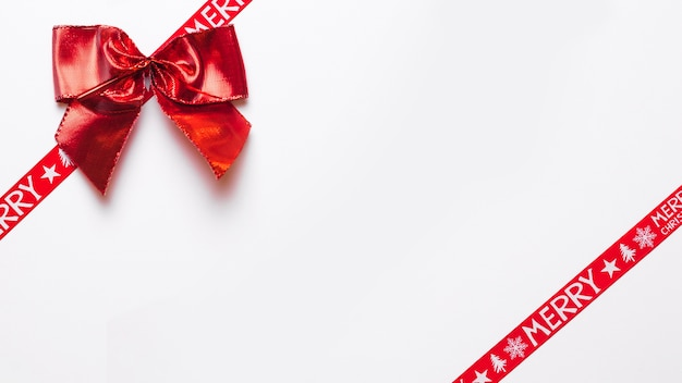 Red bow with wrap ribbons Free Photo