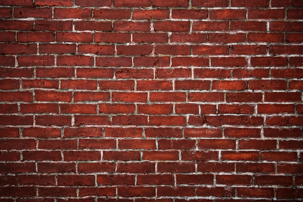 Red brick wall textured background Free Photo