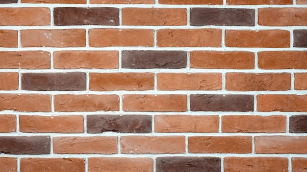 Red and brown bricks wall background Free Photo