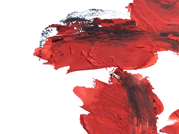 Red brush strokes with black traces Free Photo