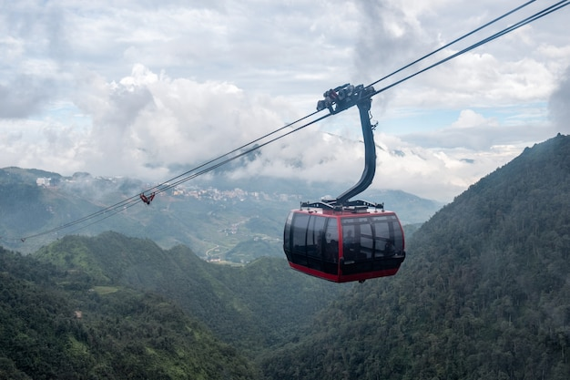 Red cable car sightseeing sapa village in valley Premium Photo