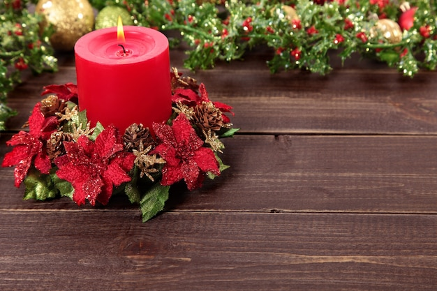 red candle with christmas decorations free photo