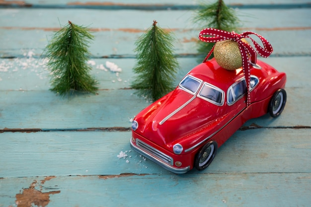 Red car with a christmas ball on top Free Photo