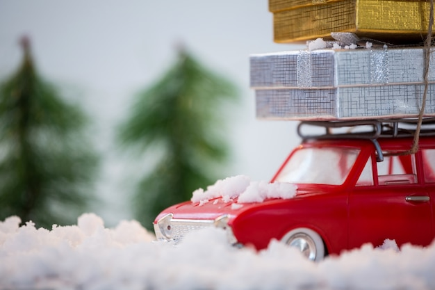 Red car with gifts on top Free Photo