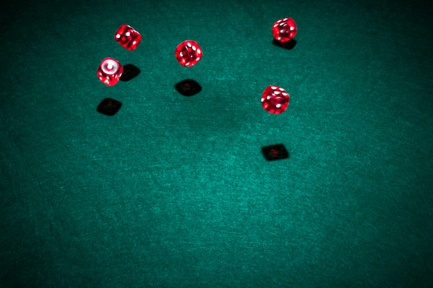 Red casino dice over the poker table Free Photo