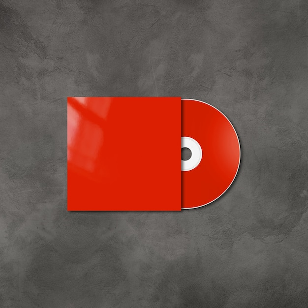 Red cd - dvd label and cover mockup template isolated on concrete Premium Photo
