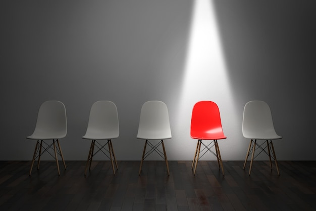 A red chair under bright light. 3d render Premium Photo