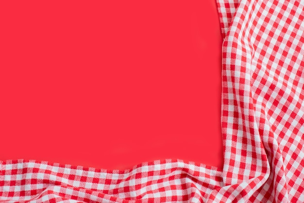 Red checkered tablecloth on a red. Premium Photo