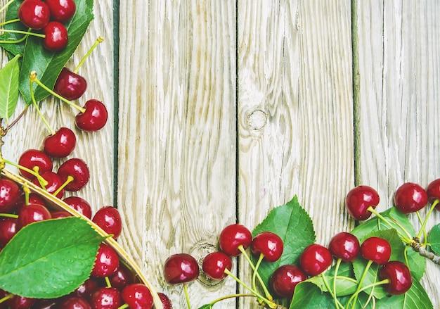 Red cherries. selective focus. food nature fruit. Premium Photo