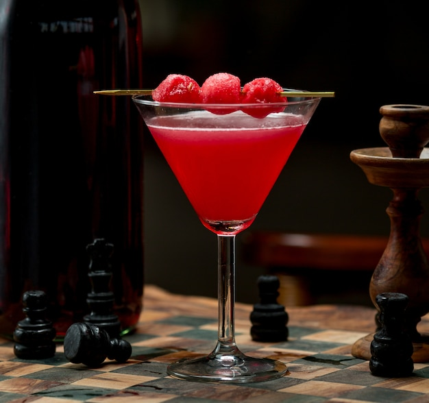 Red cherry cosmopolitan with cherry berries on the top Free Photo